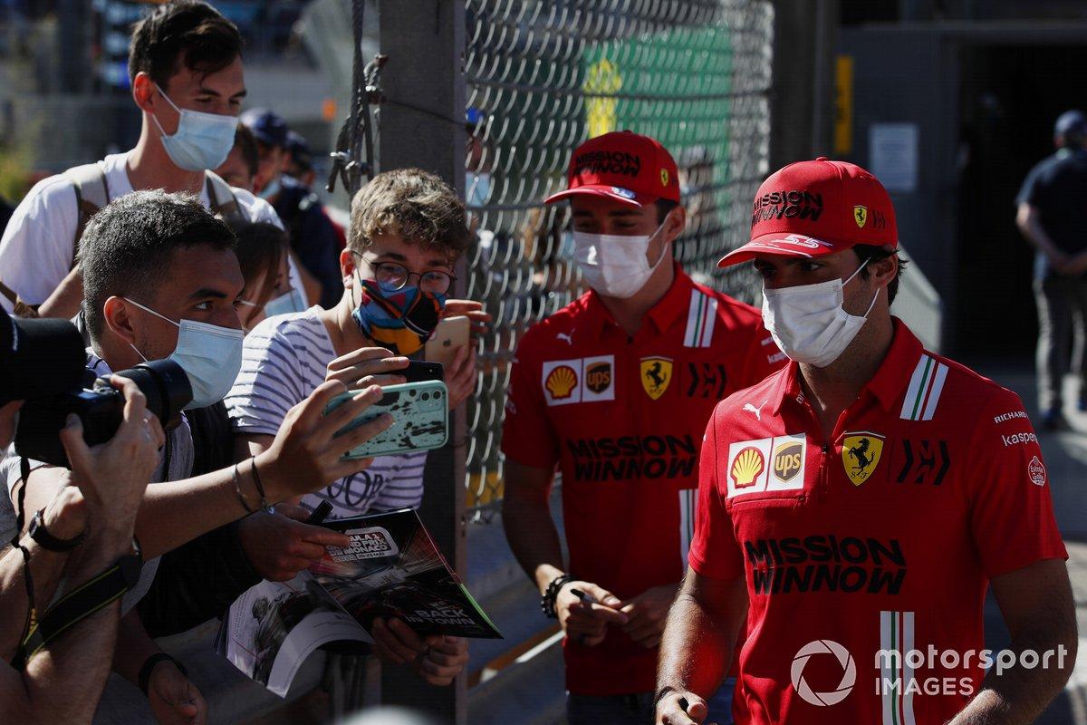 Charles Leclerc, Ferrari, and Carlos Sainz Jr., Ferrari, have their photos taken with fans