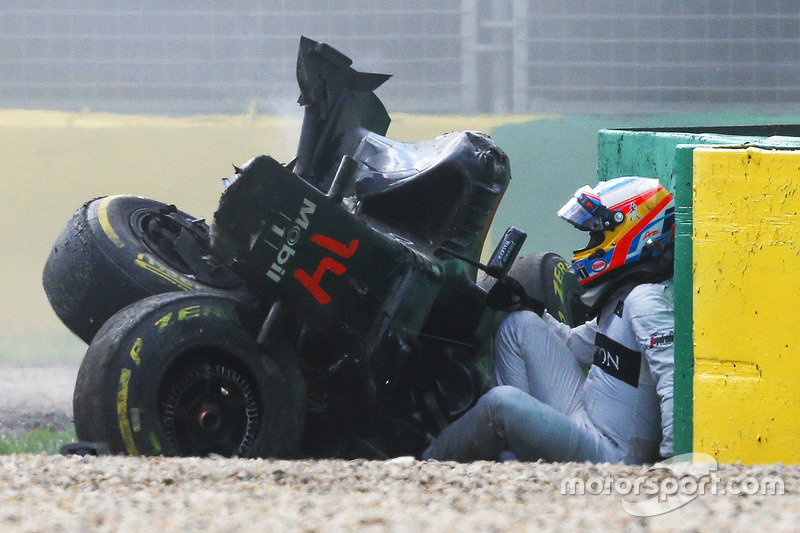 Alonso takes a moment after a terrifying impact