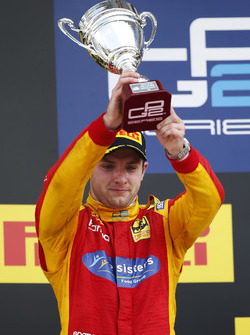 Jordan King, Racing Engineering lifts his trophy after finishing second