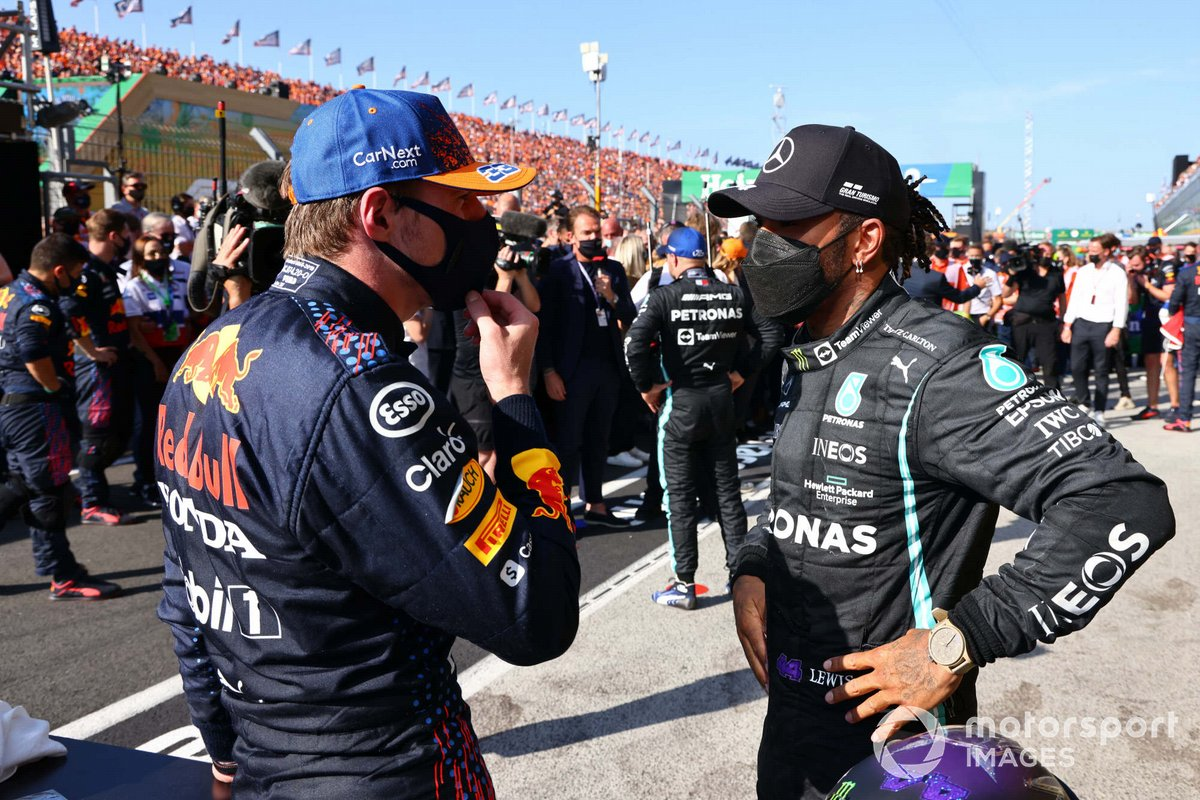 Max Verstappen, Red Bull Racing, 1st position, and Lewis Hamilton, Mercedes, 2nd position, talk after the race