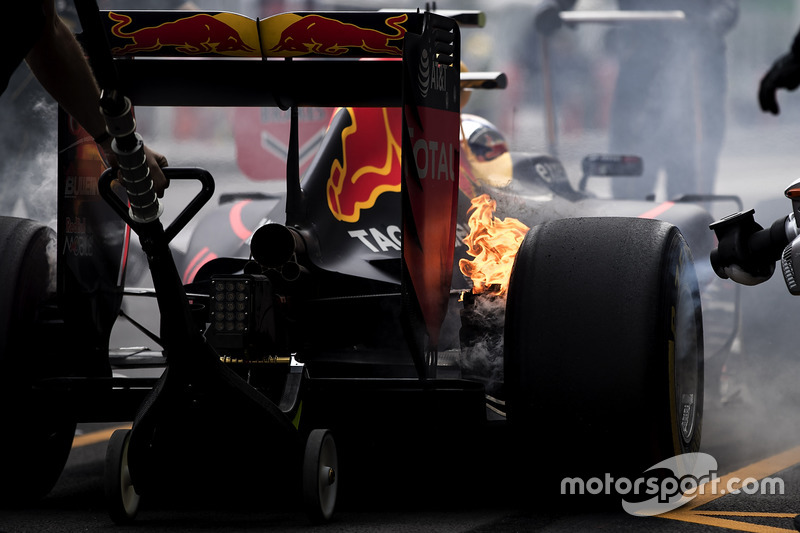 1. The brakes of Max Verstappen, Red Bull Racing RB12, catch fire in the pits