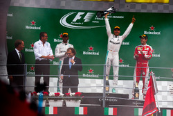Podium (L to R): second place Lewis Hamilton, Mercedes AMG F1; Race winner Nico Rosberg, Mercedes AMG F1; third place Sebastian Vettel, Ferrari