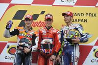 MotoGP Photos - Podium: Race winner Casey Stoner, Ducati; second place Andrea Dovizioso; Repsol Honda; third place Valentino Rossi, Yamaha