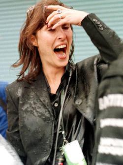 Mika Hakkinen's wife Erja is sprayed with champagne