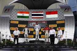 Alexander Albon, ART Grand Prix; Arjun Maini, Jenzer Motorsport and Charles Leclerc, ART Grand Prix stand on the podium