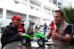Niki Lauda, Mercedes Non-Executive Chairman and Ernst Hausleitner, ORF Presenter with a squirrel on a quad bike.