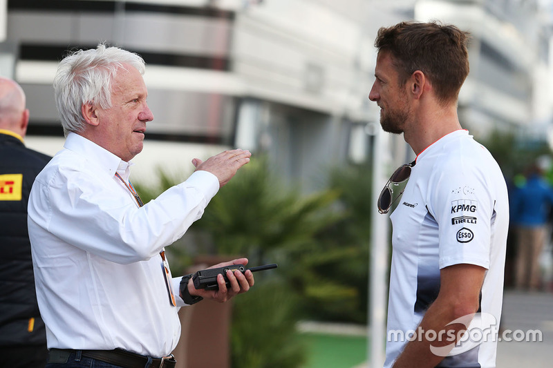 Charlie Whiting, FIA Delegate with Jenson Button, McLaren