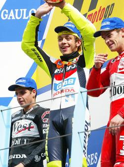 Podium: winner Valentino Rossi, Honda Team, second place Alex Barros, Honda Pons, third place Carlos Checa, Yamaha Team