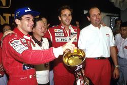 1991 World Champion Ayrton Senna, race winner Gerhard Berger, McLaren CEO Ron Dennis