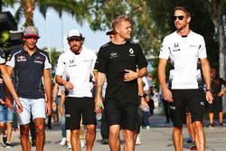 (L to R): Kevin Magnussen, Renault Sport F1 Team with Jenson Button, McLaren