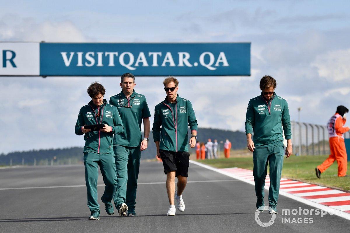 Sebastian Vettel, Aston Martin, walks the track with members of his team