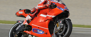 MotoGP Stoner storms to emotional pole in Valencia