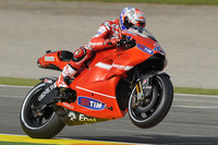 Stoner storms to emotional pole in Valencia