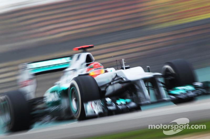Schumacher tops Friday practice in damp, cold Shanghai