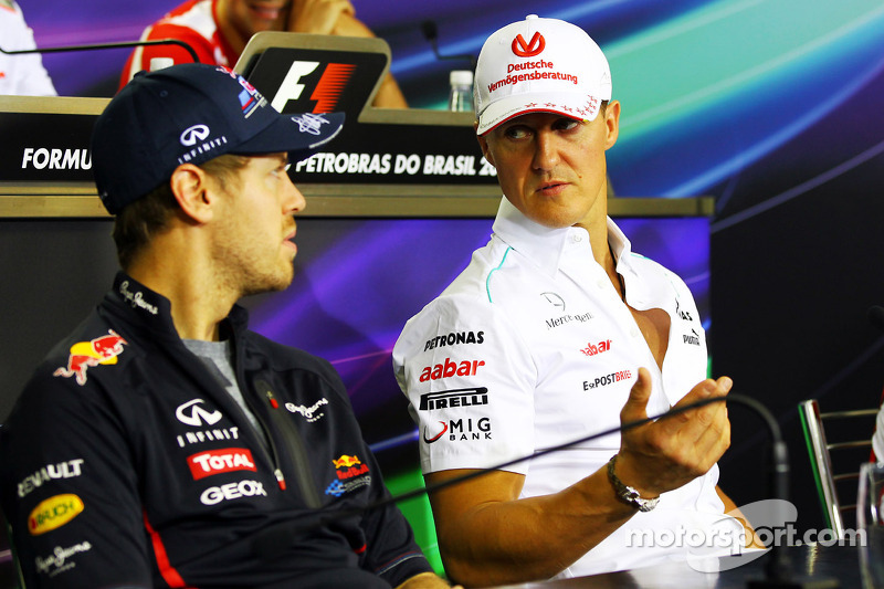 Vettel hopes for 'miracle' a month into Schumacher coma