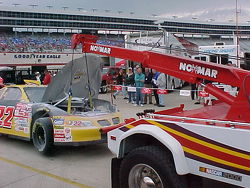 Ward Burton's wrecked CAT car on the hook