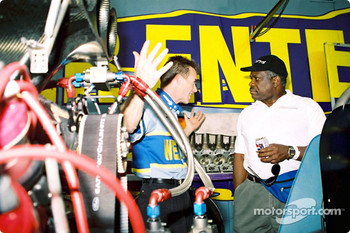Supreme Court Justice Clarence Thomas is a drag racing fan and attended the race as a spectator along with his son and grandson. Top fuel pilot Clay Millican shows the Justice how a top fuel dragster operates