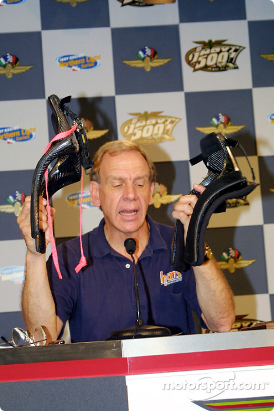 Robert Hubbard displays two types of HANS devices