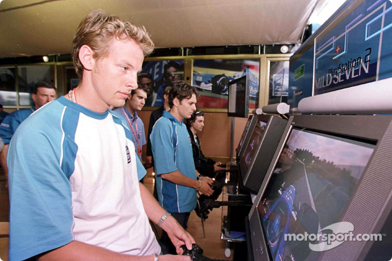 Jenson Button and Giancarlo Fisichella try the new Sony Playstation 2
