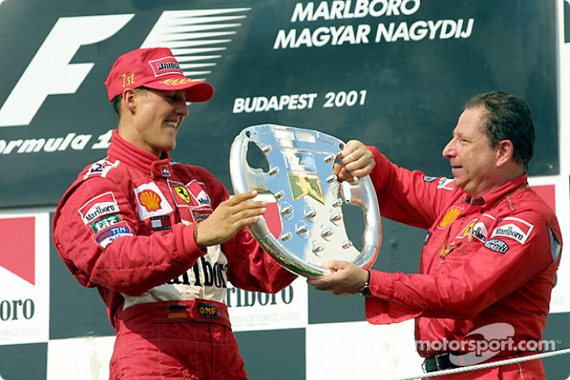 Michael Schumacher and Jean Todt with the trophy