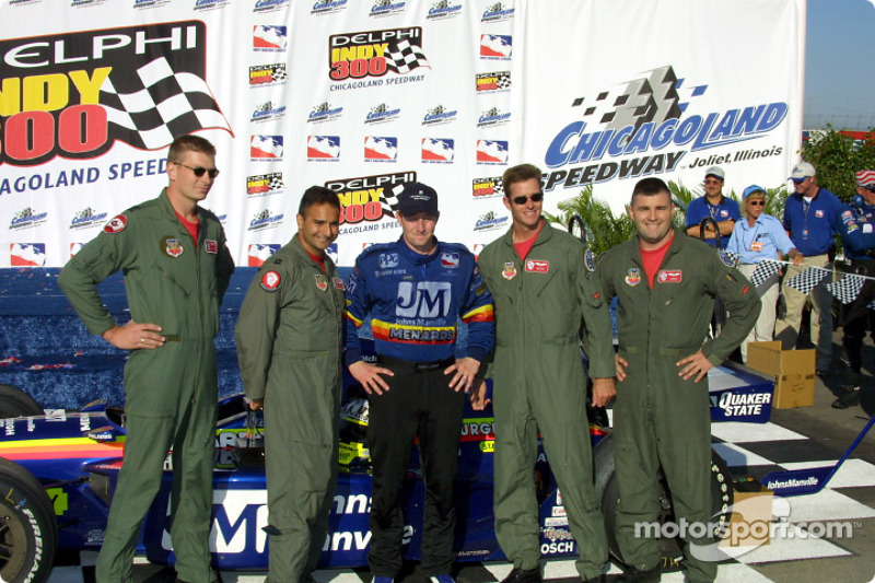 Jaques Lazier with armed forces members