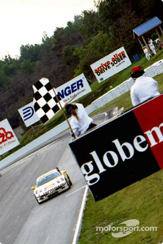 The #11 Powell Motorsports Corvettes takes the checkered flag