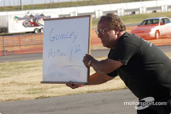 Crewmember Paul Harraka signals driver Justin Gumley that he is in first place