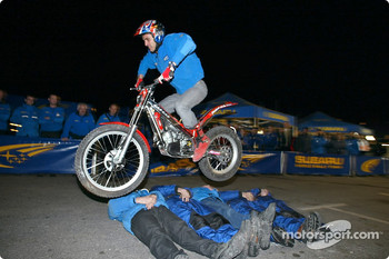 Trial rider Steve Collie jumps over some of the SWRT mechanics