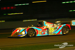 The #38 Porsche Lola's colors shone brightly under the lights