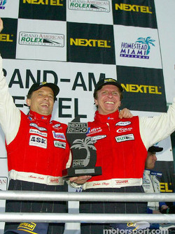 Didier Theys and Mauro Baldi, drivers of the #27 Judd Dallara, celebrate in Victory Lane after winning the Nextel 250