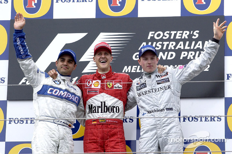 The podium: race winner Michael Schumacher, with Juan Pablo Montoya and Kimi Raikkonen