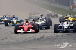 The start: Michael Schumacher battling with Juan Pablo Montoya