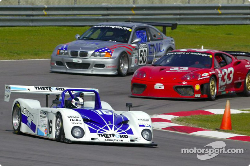 James Weaver leads two GT cars through California Speedway's infield during practice for the inaugural Grand American 400