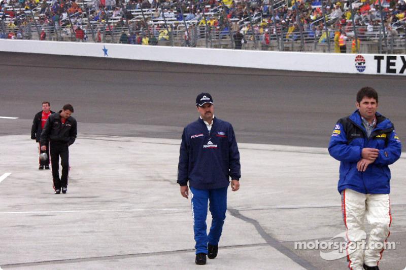 Green, Keller, Sprague, and Nemechek come back from inspecting the track