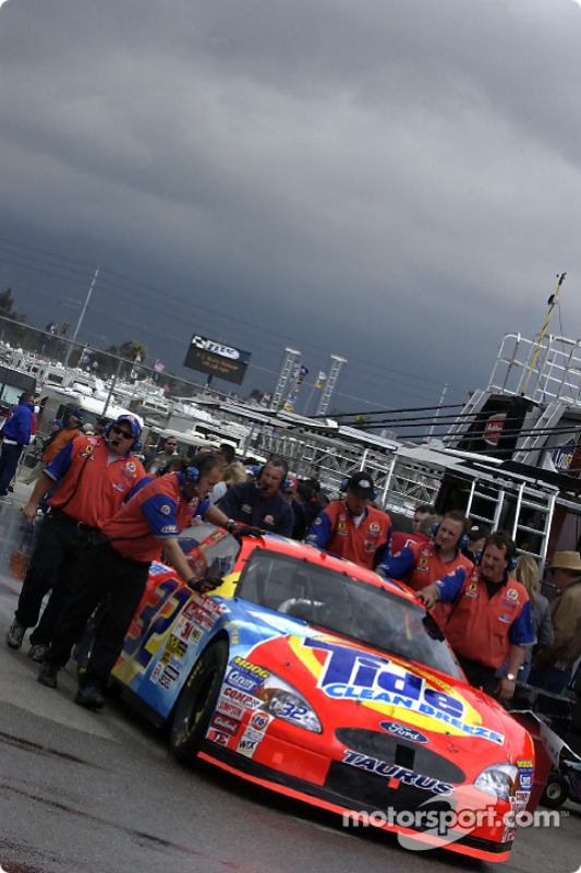 Tide Ford Taurus of Ricky Craven being pushed through the garage area