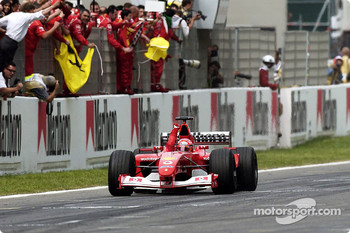 Michael Schumacher taking the checkered flag