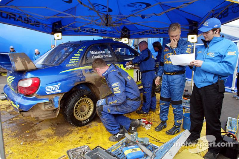 Subaru World Rally Team mechanics working on the Impreza WRC