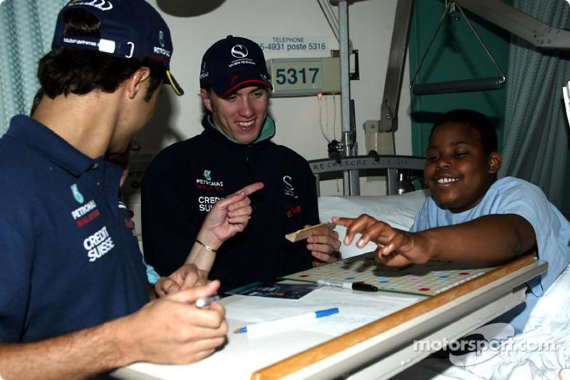 Visit of the Sainte-Justine Children hospital of Montreal: Nick Heidfeld and Felipe Massa