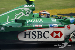 Eddie Irvine going the wrong way after a spin