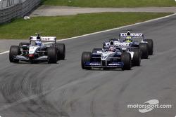 Juan Pablo Montoya, Kimi Raikkonen and Ralf Schumacher battling