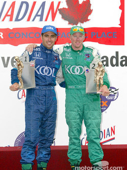 The podium: race winner Dario Franchitti with Paul Tracy