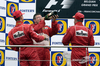 The podium: champagne for Michael Schumacher, Rubens Barrichello and Ross Brawn