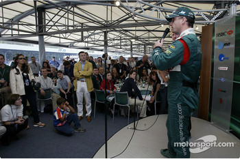 Eddie Irvine talks to AT&T guests in the paddock club