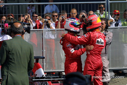 Race winner Rubens Barrichello congratulated by Michael Schumacher
