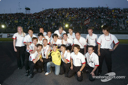 Takuma Sato celebrates his first points in Formula 1 with Honda team members