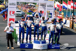 The podium: rally winner Colin McRae with Marcus Gronholm and Carlos Sainz