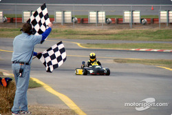Three Hours of Charlotte winner Jeff Jewell takes the checkered flag