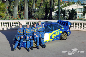 Petter Solberg, Phil Mills, Tommi Makinen and Kaj Lindstrom with the Subaru WRC 2003