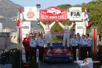 Rally winners Sbastien Loeb and Daniel Elena celebrate with the team