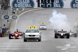 The safety car leads Rubens Barrichello and David Coulthard during the pace lap